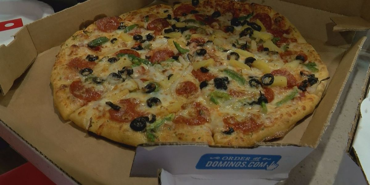 Domino's Pizza Theater cooks up a grand opening