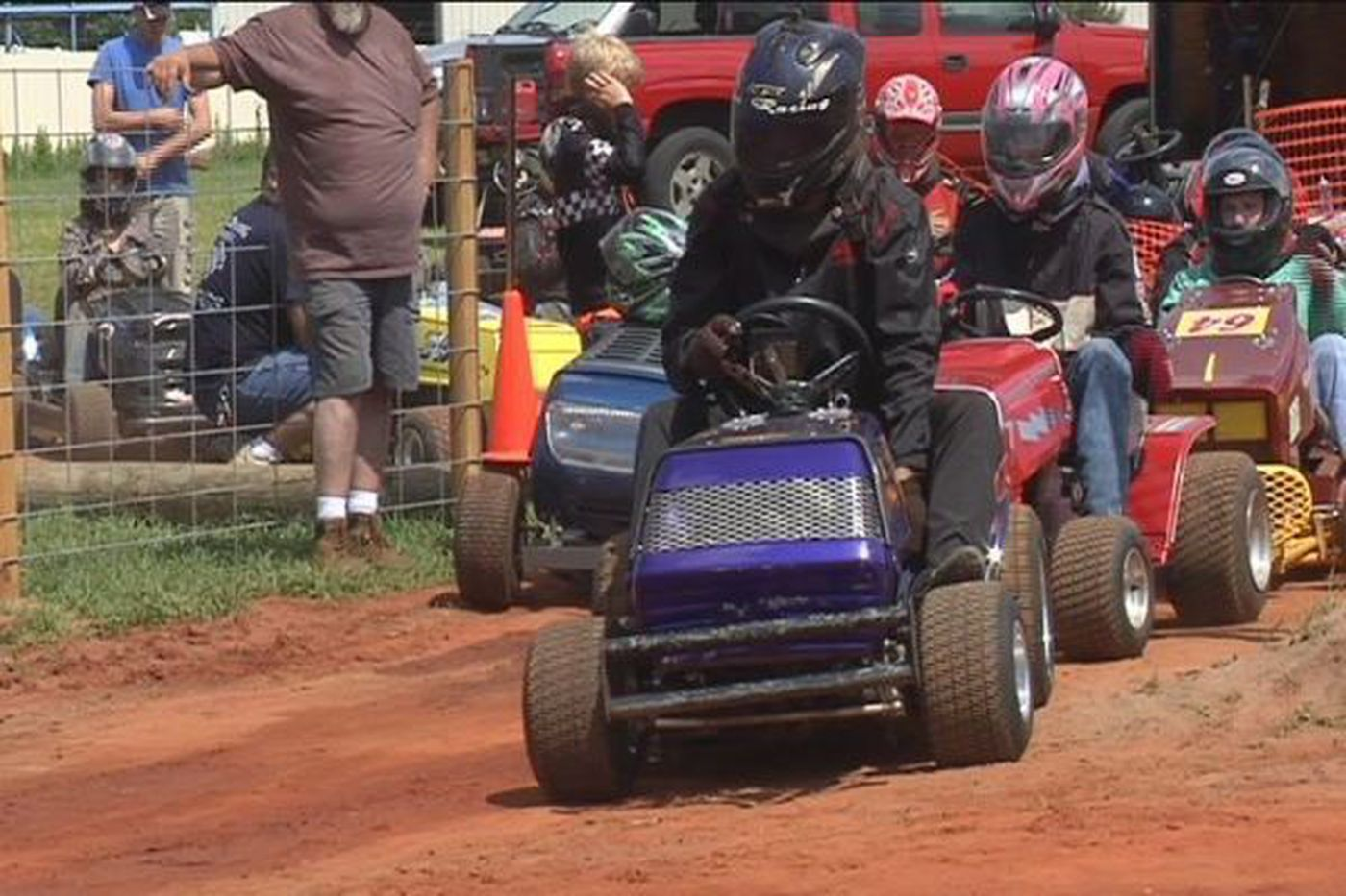 Riding lawnmowers race around Lucedale track