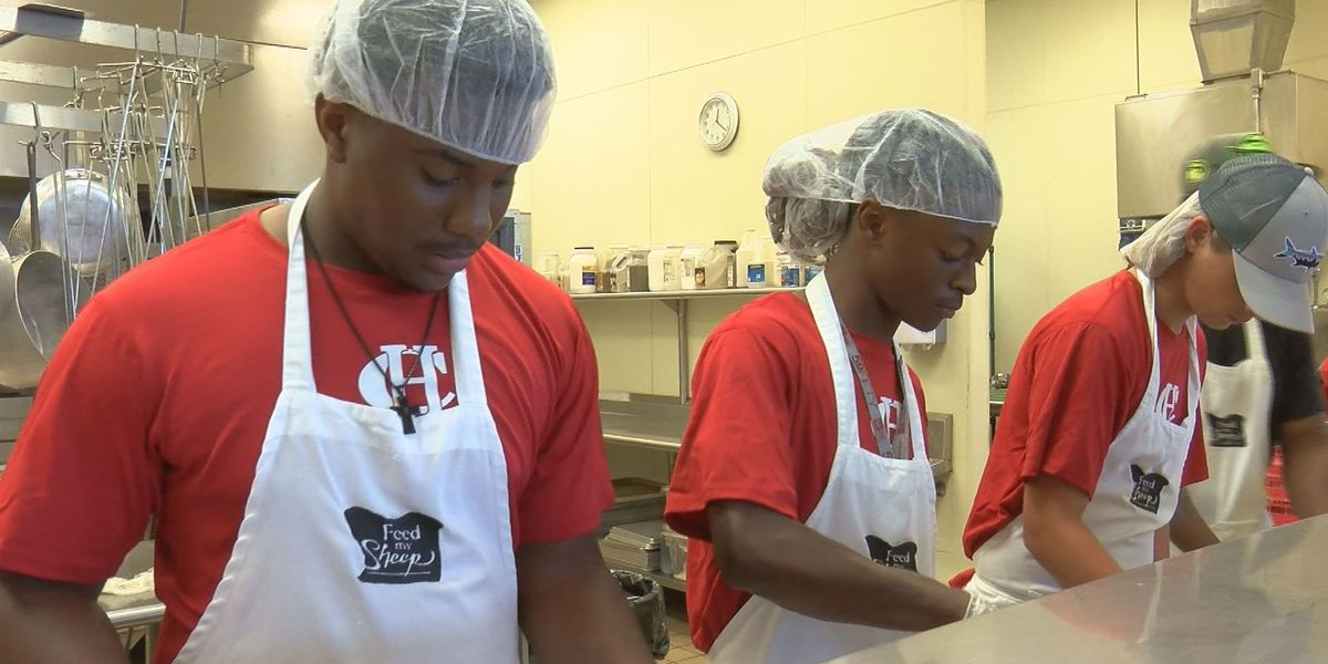Harrison Central football players give back