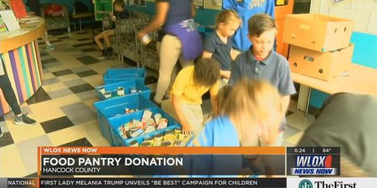 Students help stock Hancock County Food Pantry