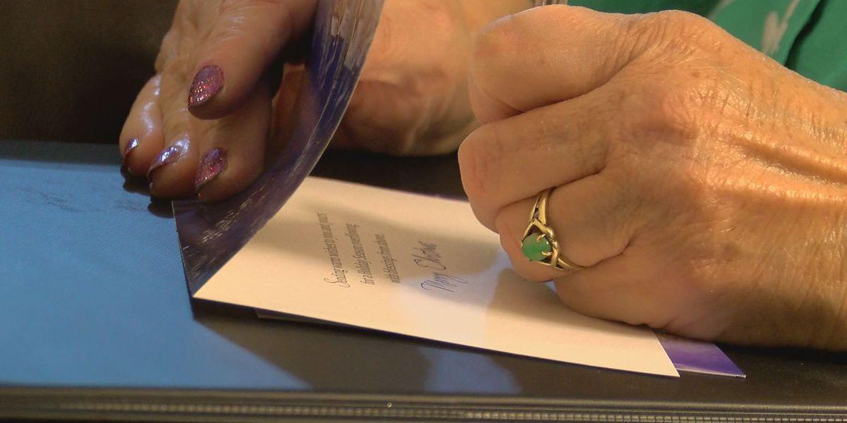 Hancock County woman spreads holiday cheer, writes 1,000 Christmas cards