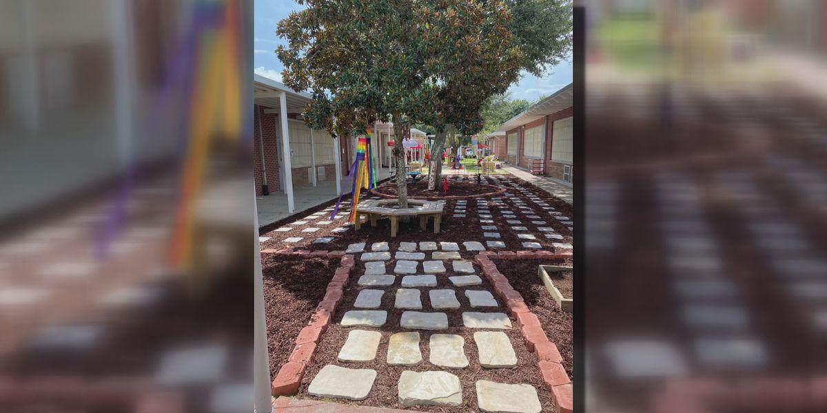 Volunteers build sensory garden at Popp's Ferry Elementary