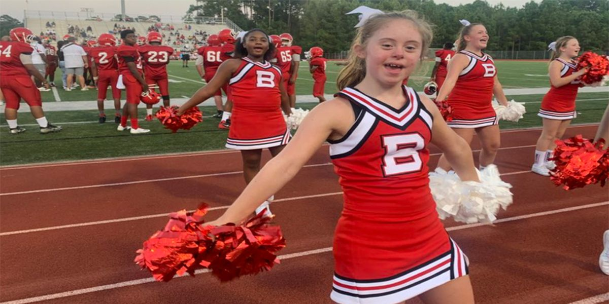Cheerleader with Down Syndrome inspires Biloxi Junior High students
