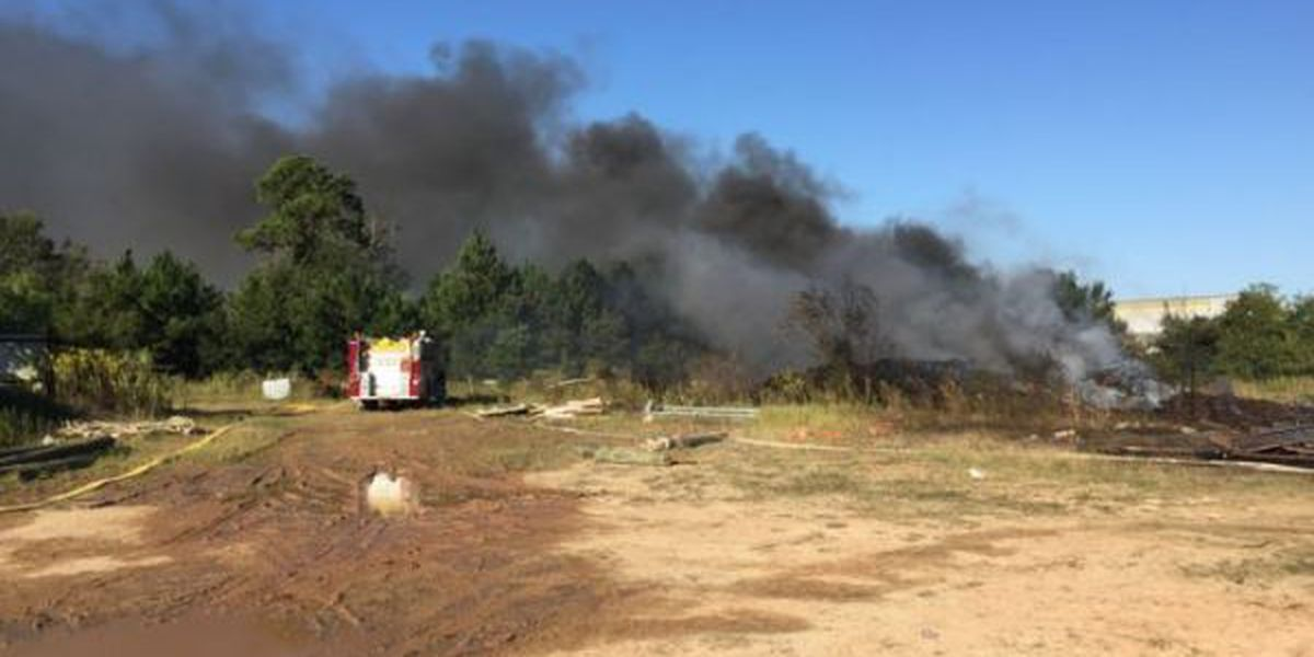 Pass Christian fire engulfs oil containment material