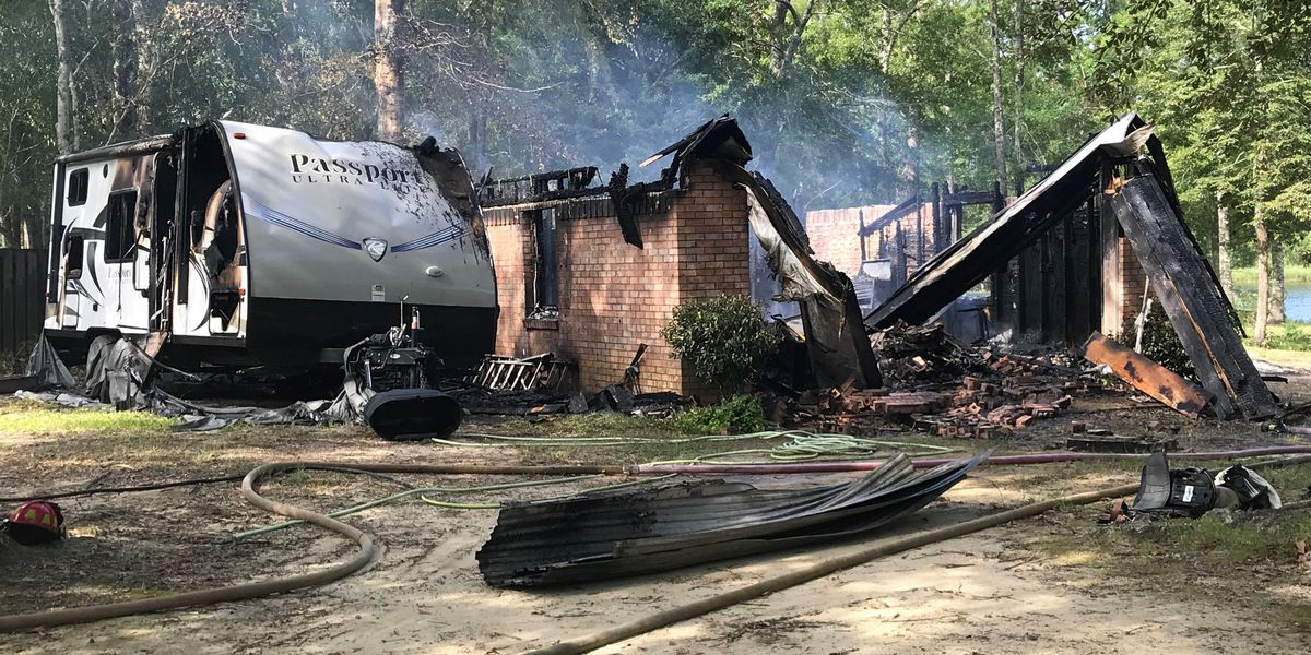 Shed, travel trailer catch fire after wind shifts flames in fire pit