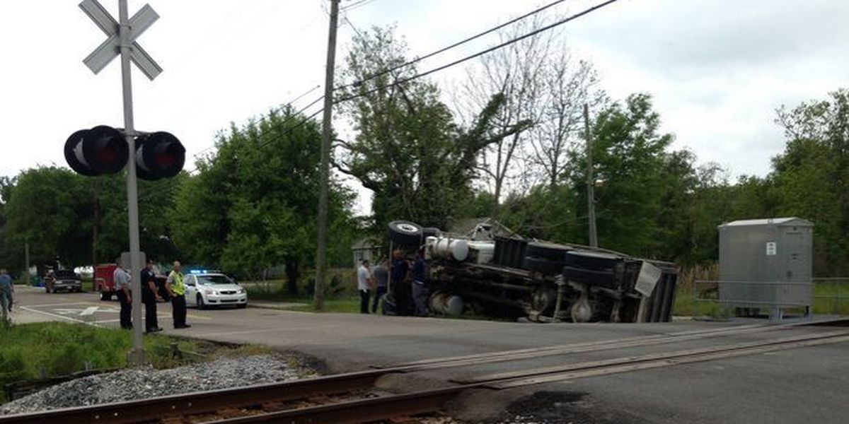 Dump truck flips causing traffic slow down in the Pass