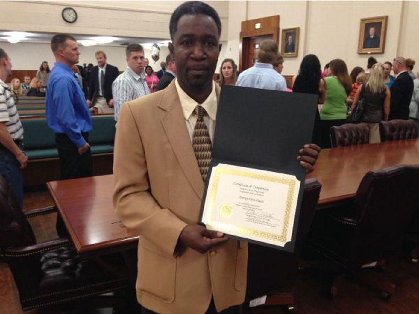 graduate danny davis shows off drug court completion certificate