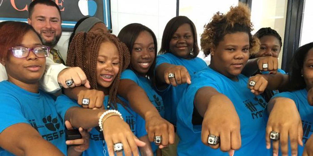Moss Point girls powerlifting team flaunts championship rings