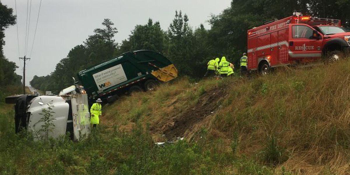 Three injured when armored truck, garbage truck collide on Hwy 26