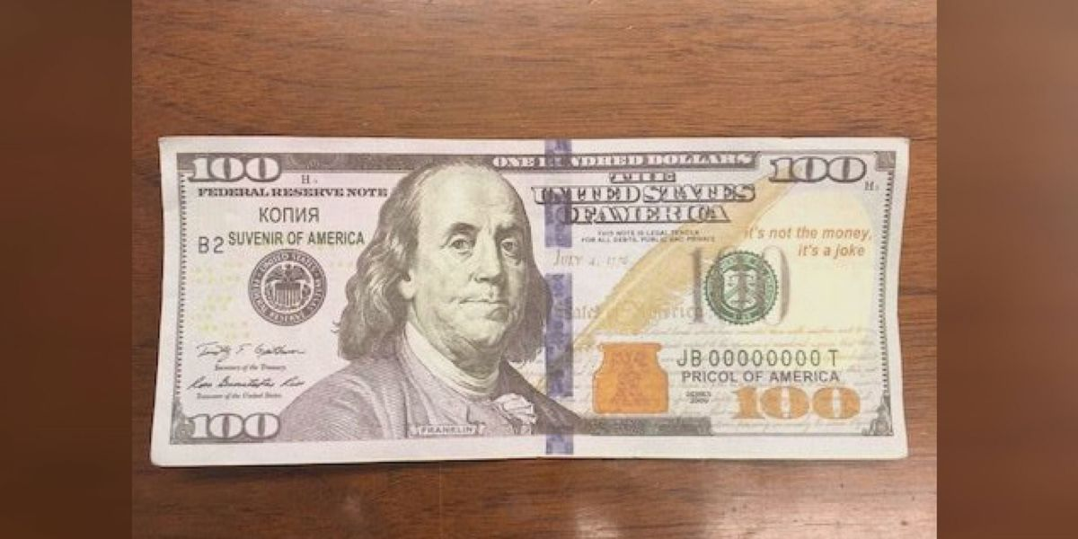 Phony $100 bills from Natchez movie set being scooped up and