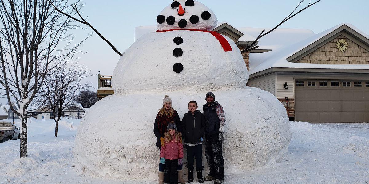 Massive Minnesota snowman towers over neighborhood