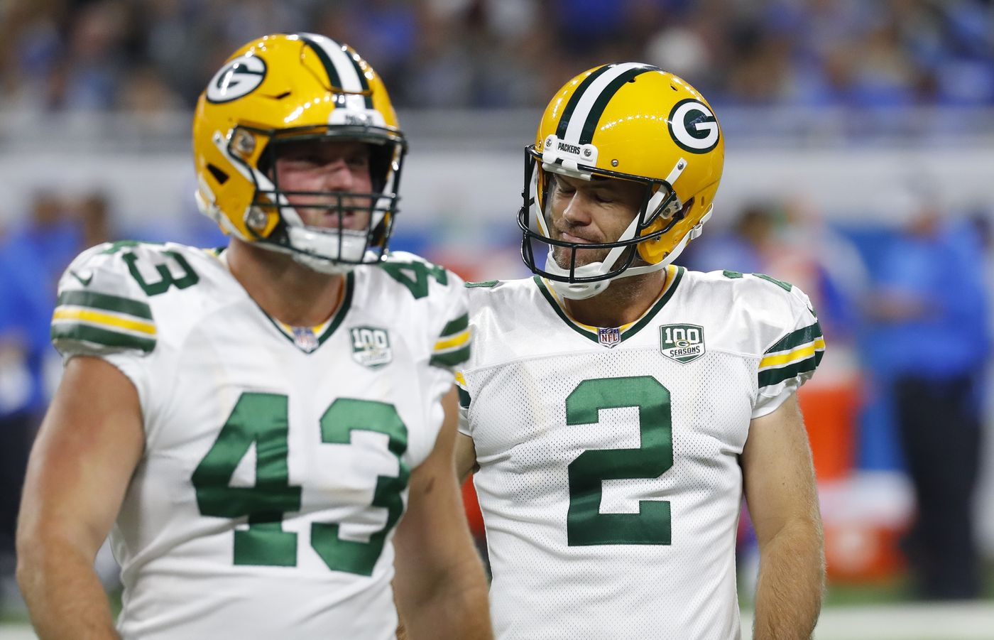 Green Bay Packers kicker Mason Crosby (2) walks off the field with teammate  Hunter bff7e28f916dd