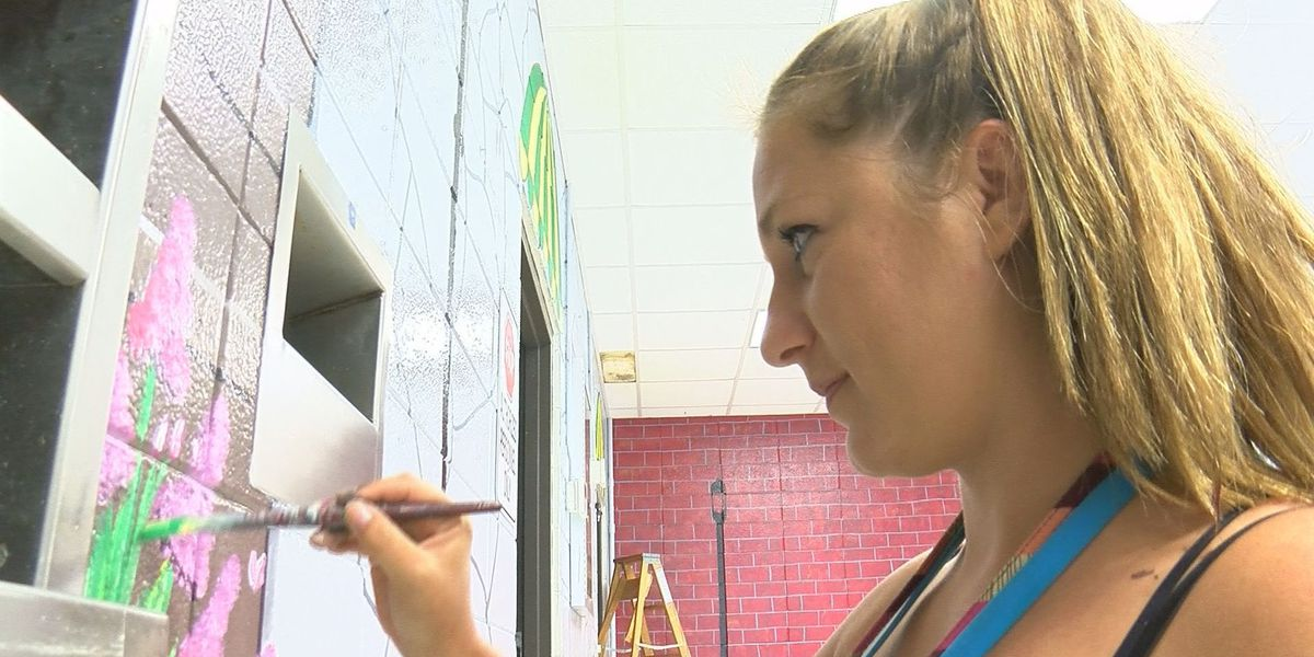 Teacher paints mural at Saucier Elementary cafeteria
