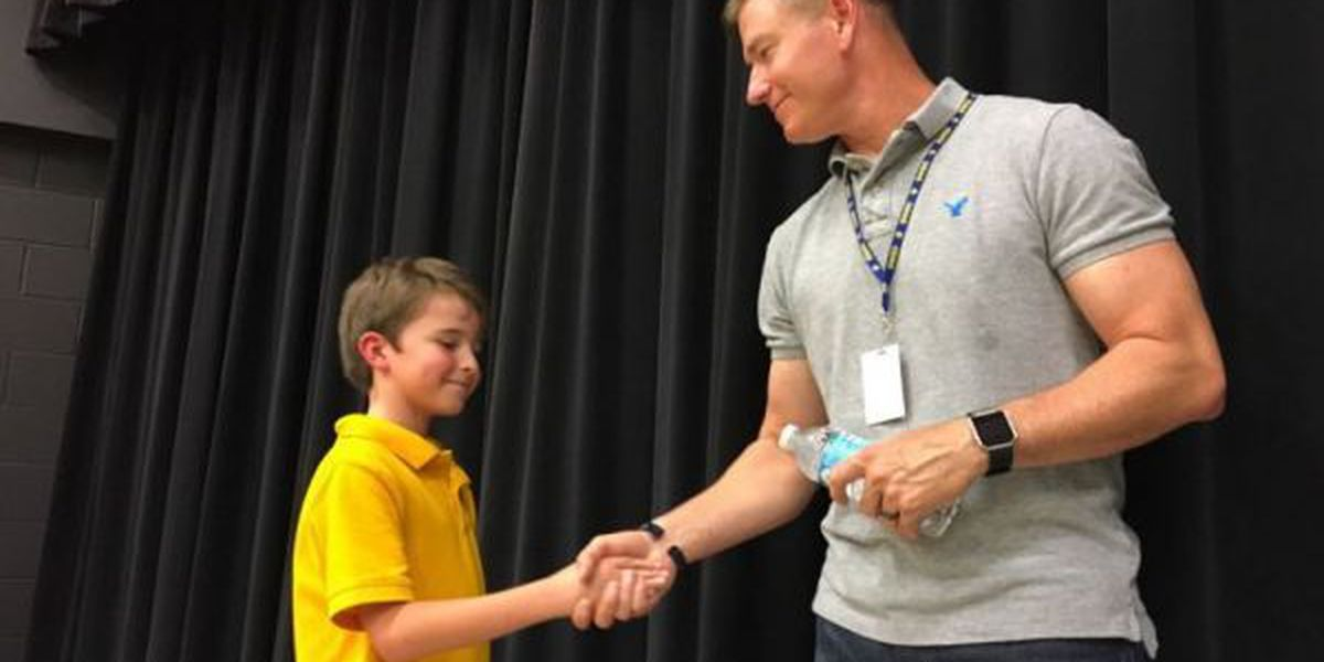 Soldier surprises students who sent care packages to his troop