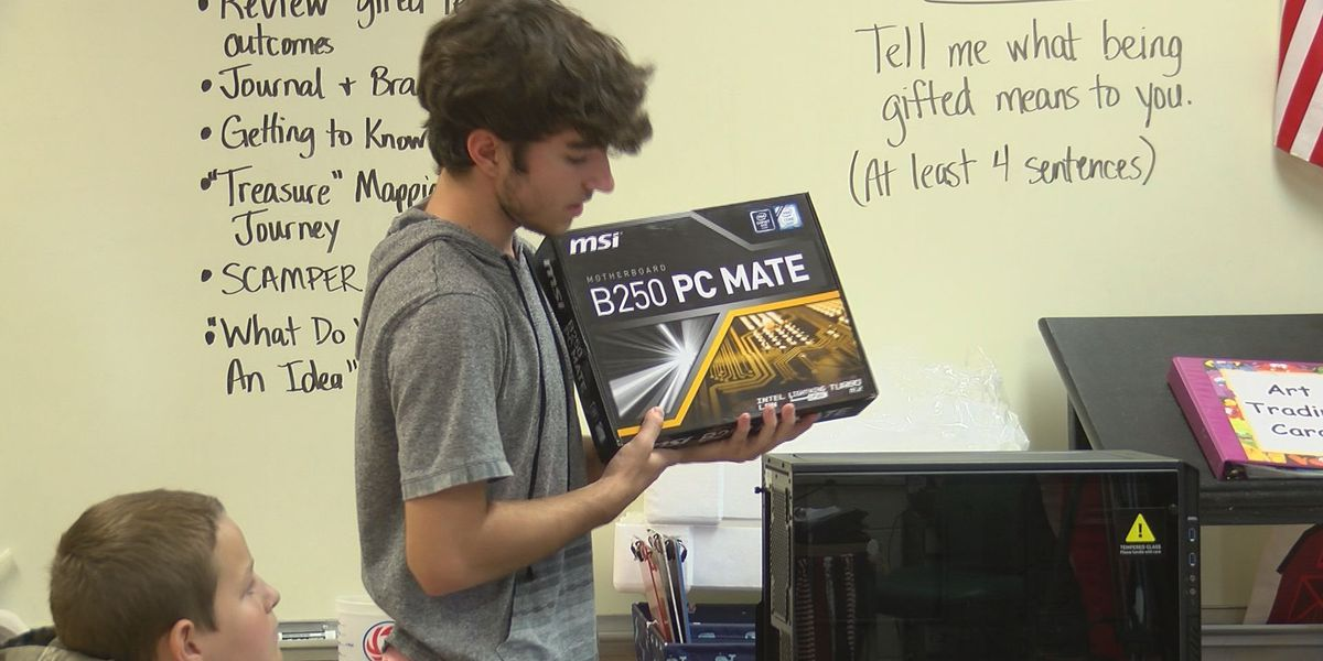 Harrison Central senior teaching gifted 6th graders how to build a computer
