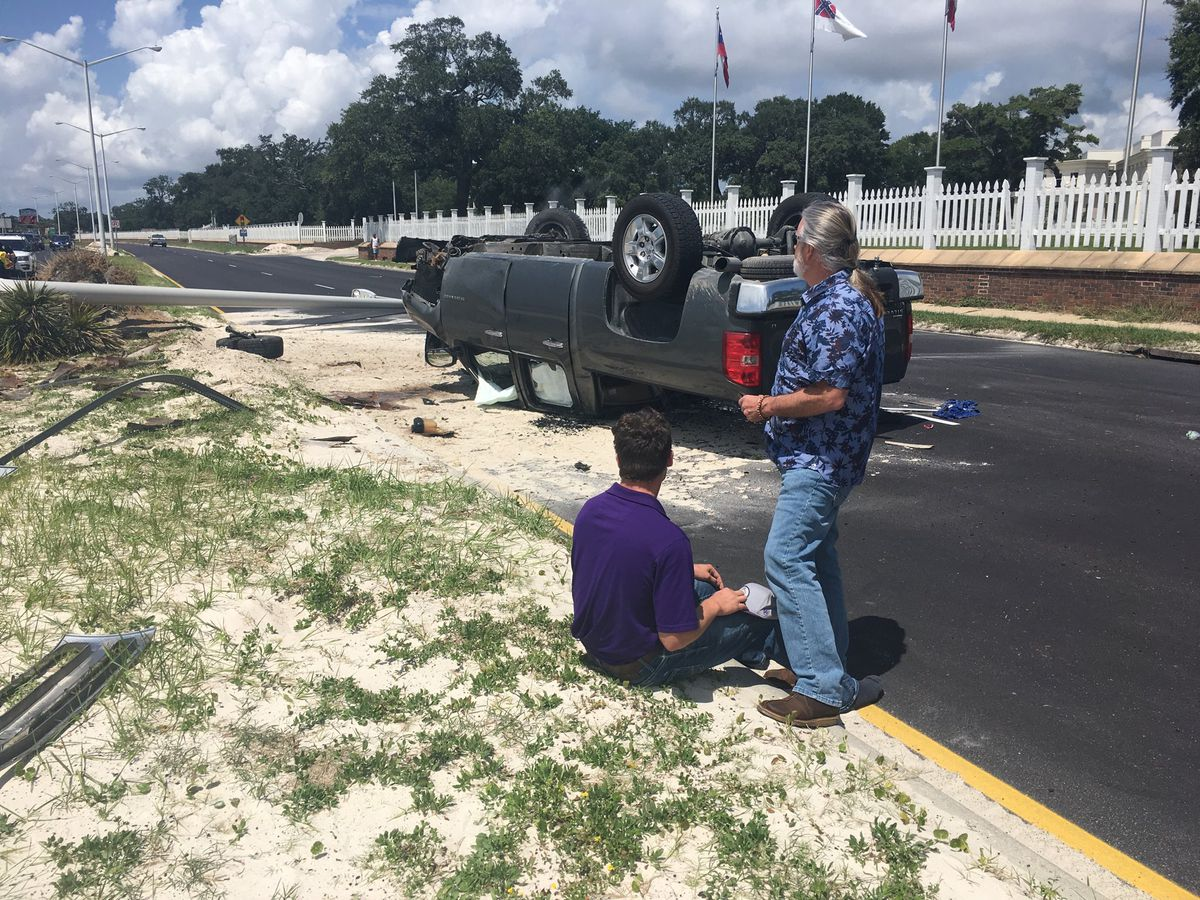 CAUGHT ON CAMERA: Truck hits light pole and flips