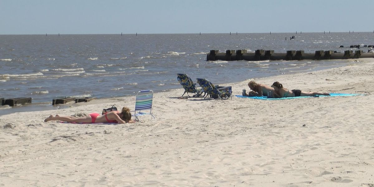Beachgoers enjoy time on re-opened Hancock County beaches