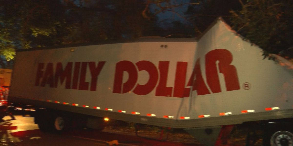 Family Dollar 18-wheeler snagged by low hanging tree branch