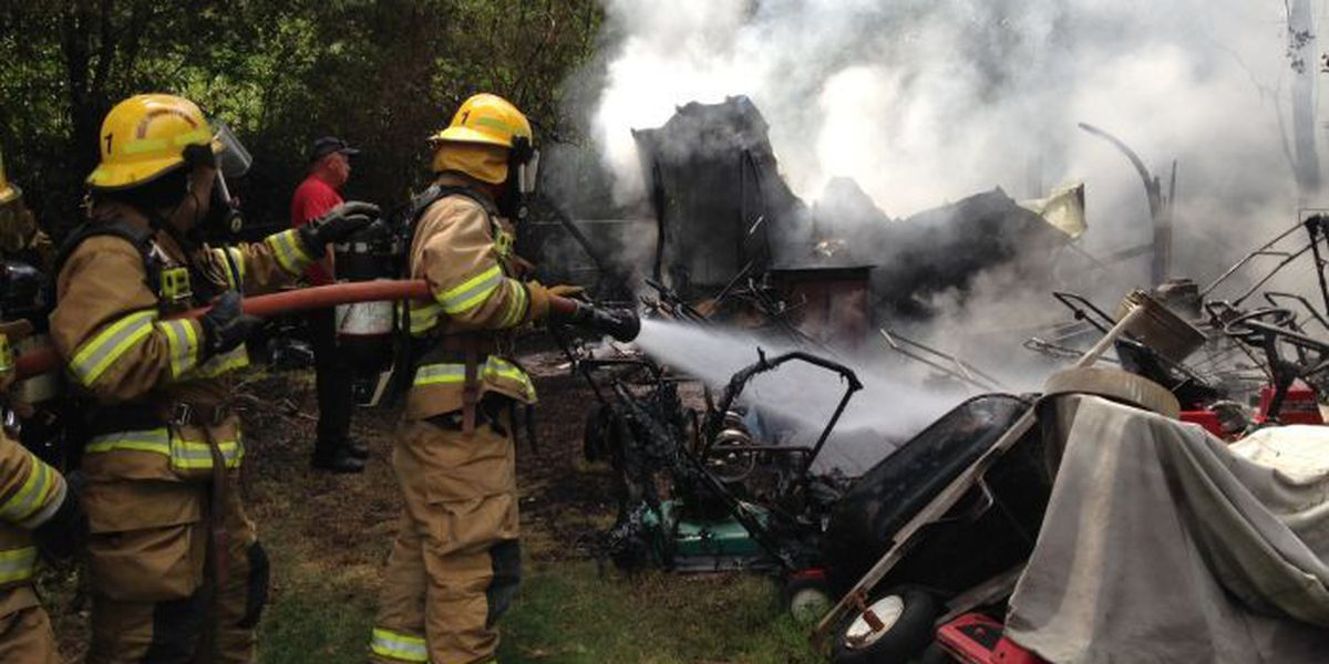 Firefighters extinguish flames inside Ocean Springs storage shed