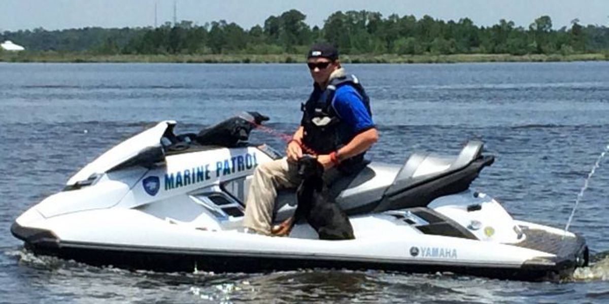 Officers on jet skis rescue dog thrown from I-110 bridge