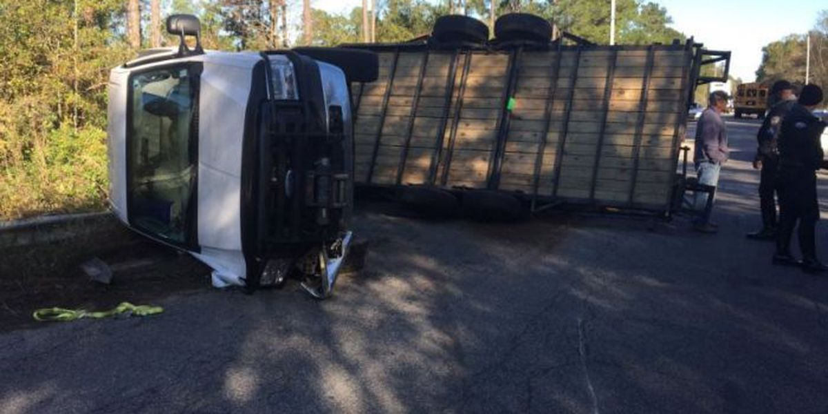 Overturned truck, trailer cleared from Canal Rd.