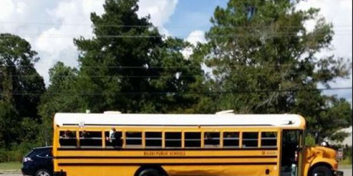 SUV plows into school bus on Popps Ferry Road, no students injured