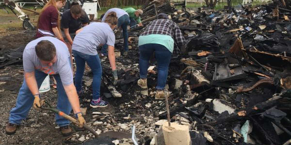 Volunteers help clean up aftermath of rescue mission fire
