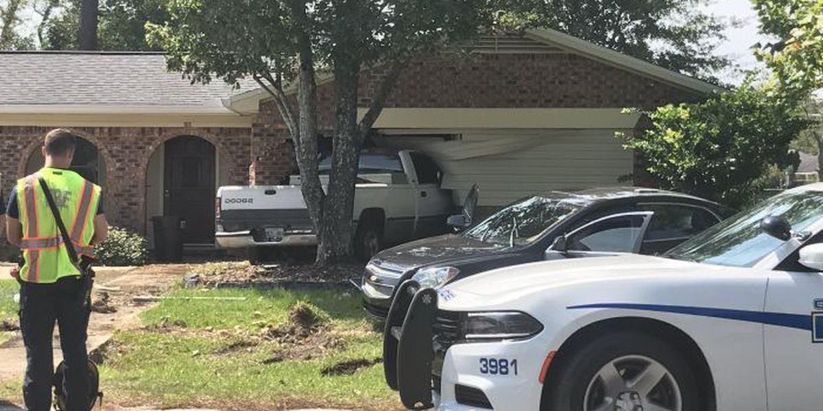 Truck slams into home in Gulfport