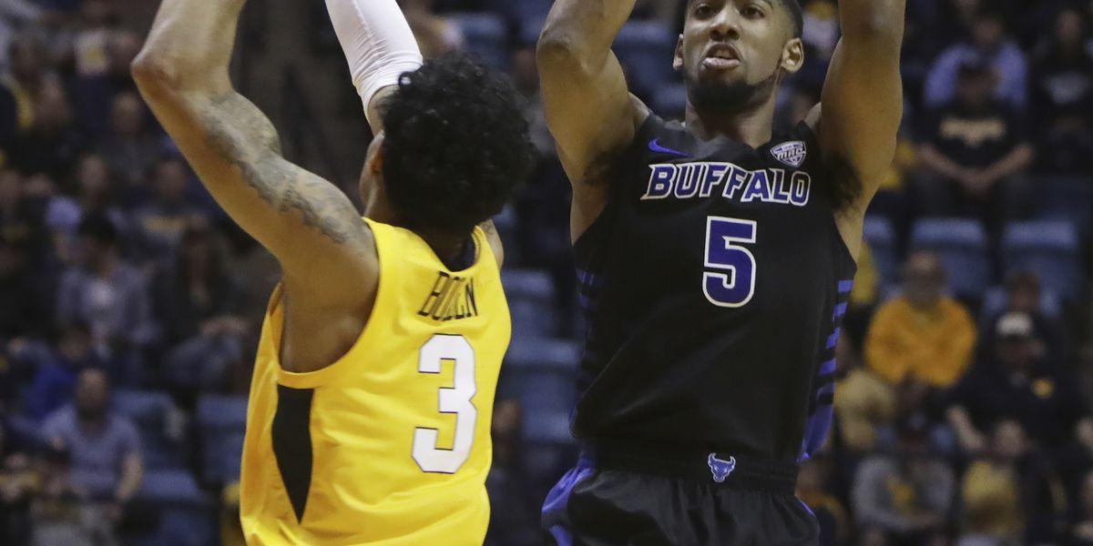 Massinburg scores 43, Buffalo stuns No. 13 WVU 99-94 in OT