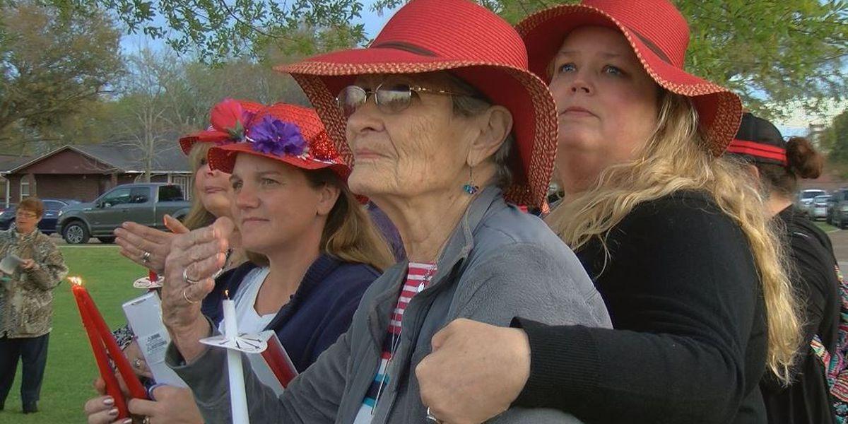 Candlelight vigil draws hundreds to Biloxi