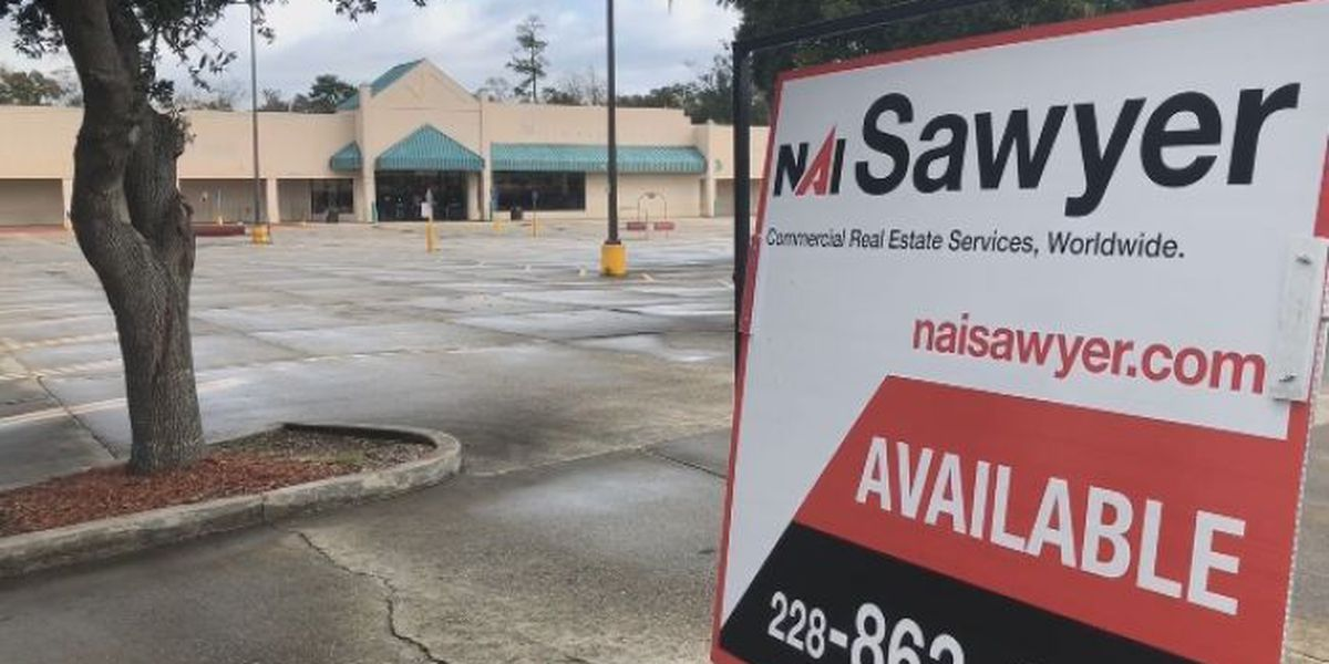 Pass Rd. 'For sale' signs highlight real estate sales slump