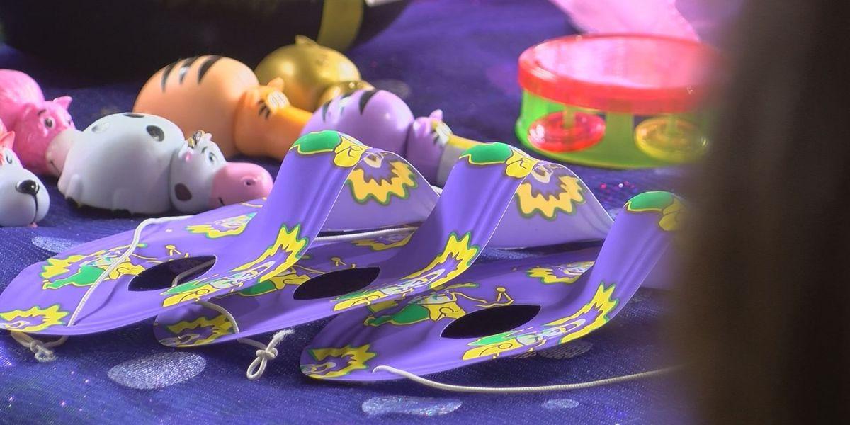 Kids enjoy Mardi Gras fun at Lynn Meadows