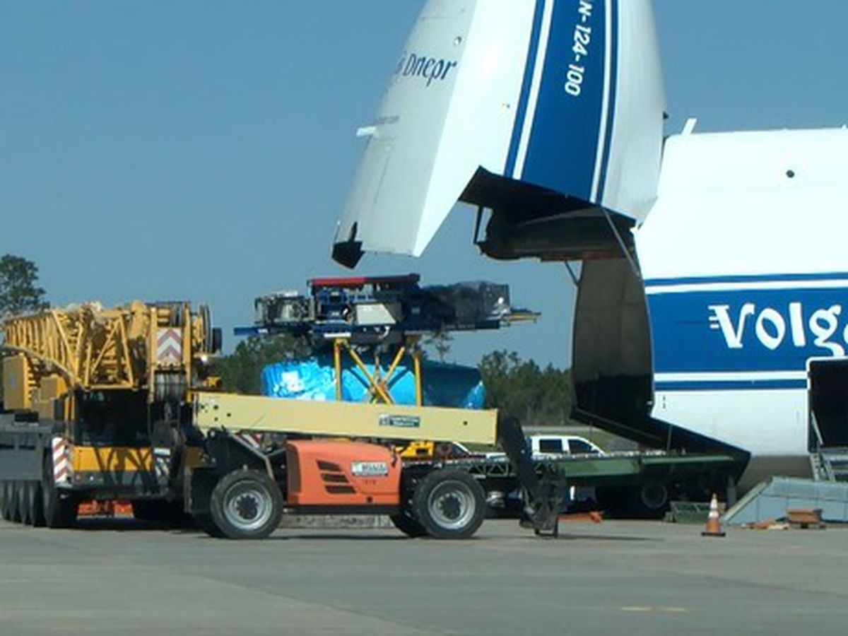 Big plane carrying big cargo at Stennis Airport