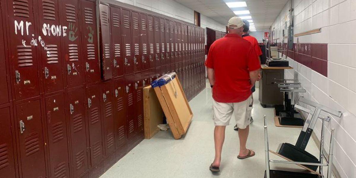 Long Beach High School alumni walk halls for last time before demolition