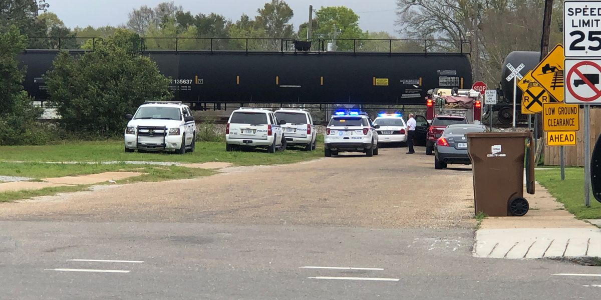 Woman injured after her truck collides with a train