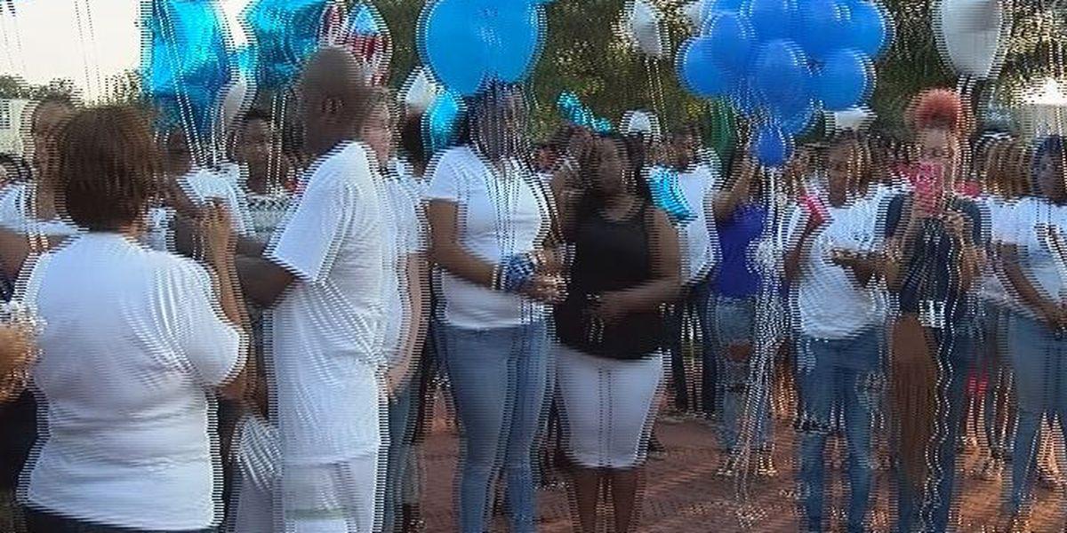 Vigil held for murdered Moss Point man