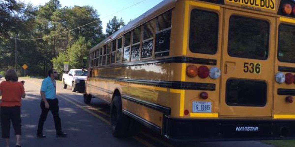 School bus driver distracted by fight; crashes into a car