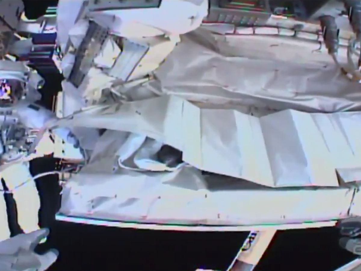 Spacewalking astronauts plug leak, finish fixing detector