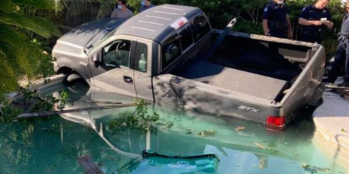 Pickup truck backs into fence, lands in Slidell swimming pool
