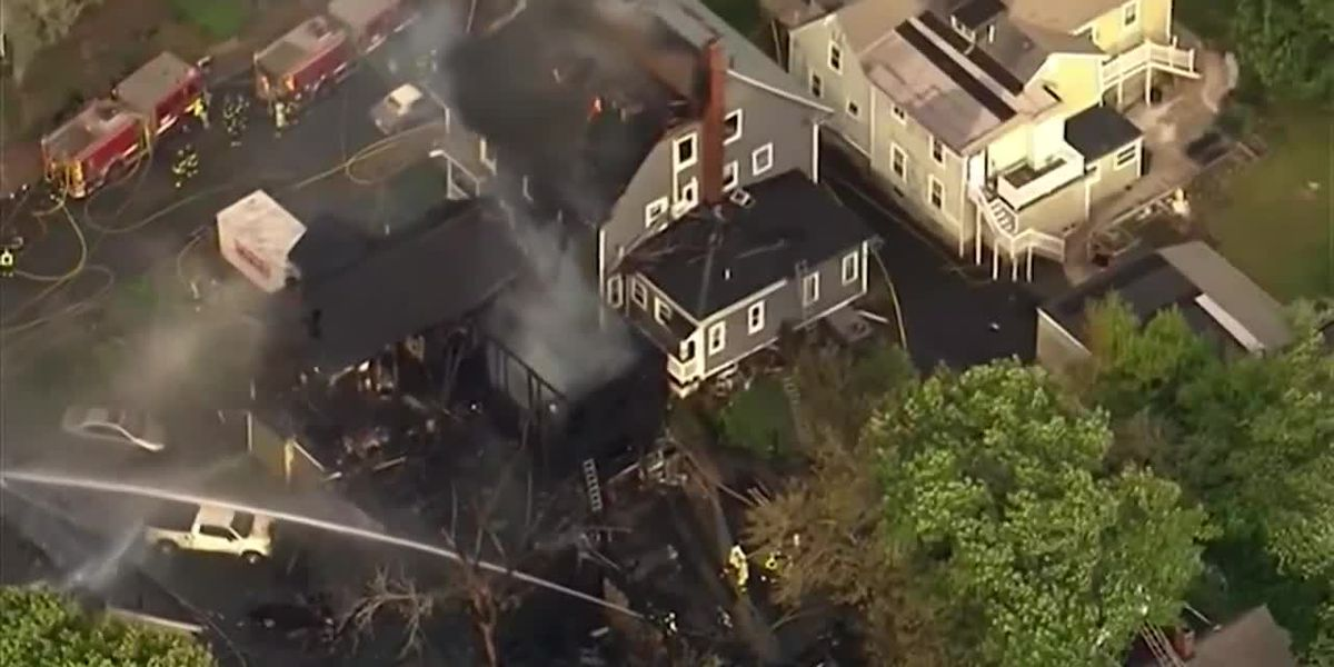 UPS driver rushes into burning Boston home, saving 2