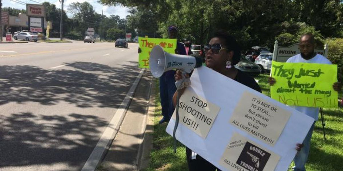 Protesters to gas station owner: 'Call 911, don't shoot'