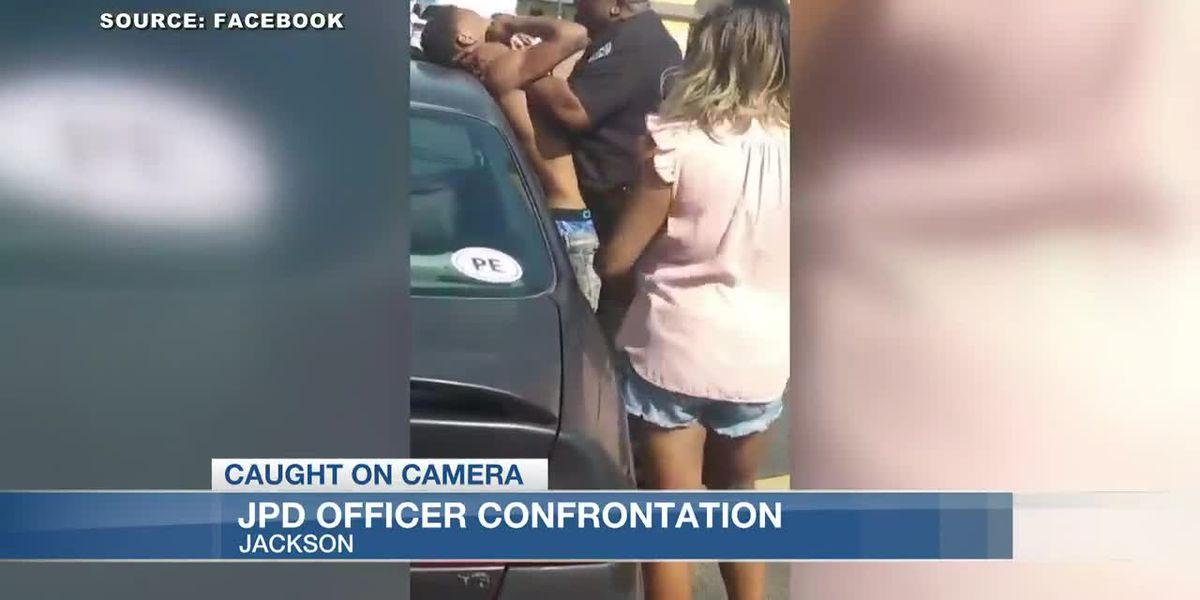 'I'm not even choking him;' JPD officer on leave after video spreads showing violent confrontation