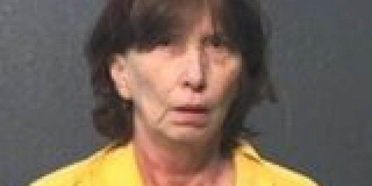 Woman accused of barricading husband in bedroom before setting fire to home