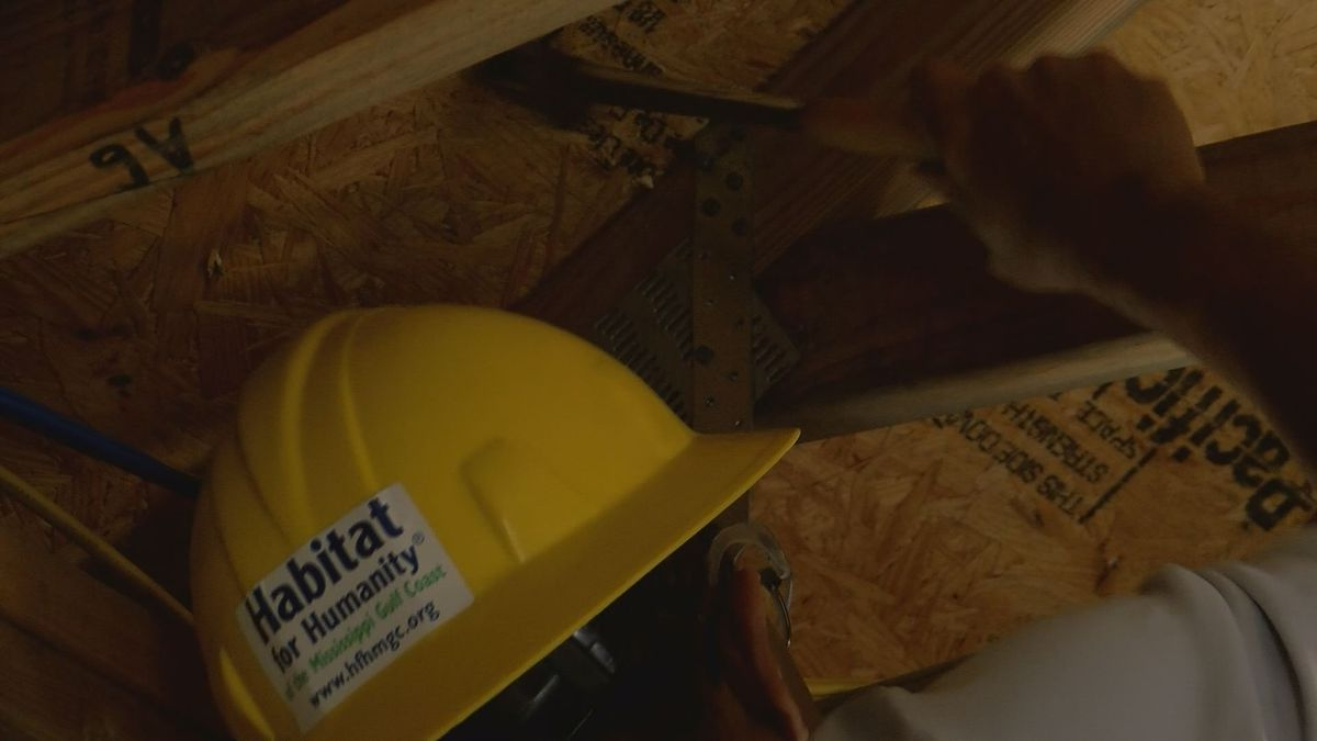 Ingalls executives volunteer with Habitat for Humanity