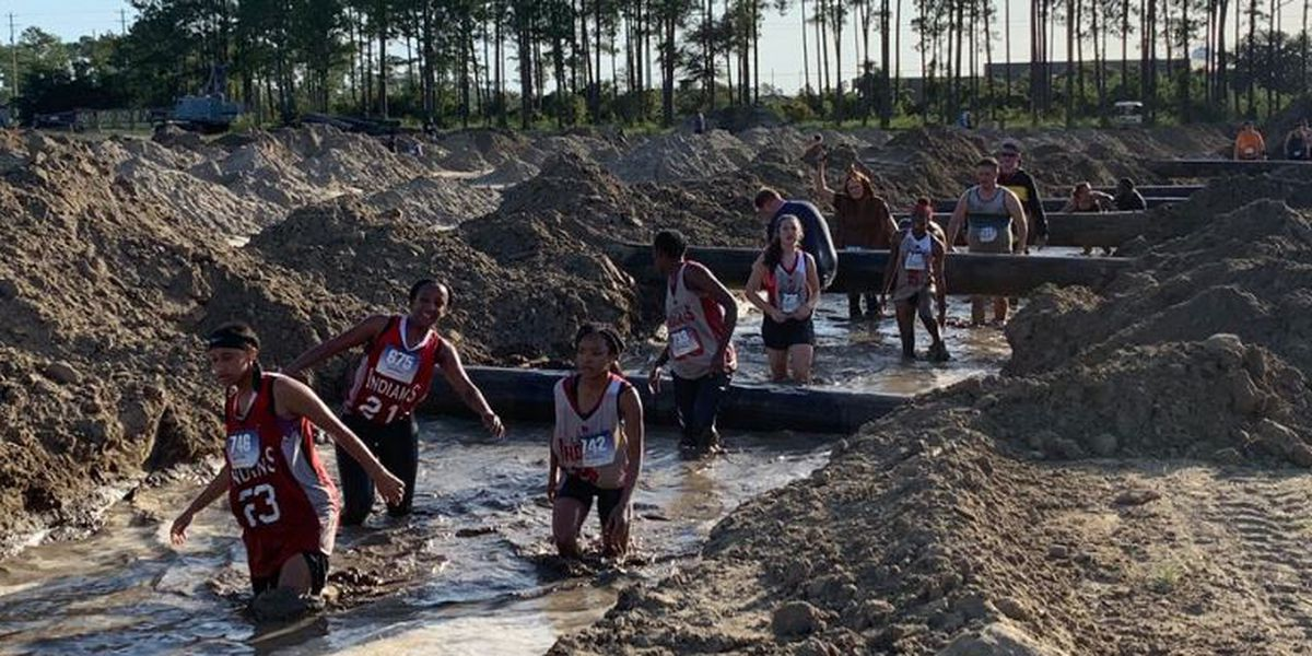 'It makes you feel like a kid again:' Hundreds compete in annual Seabee Mud Run