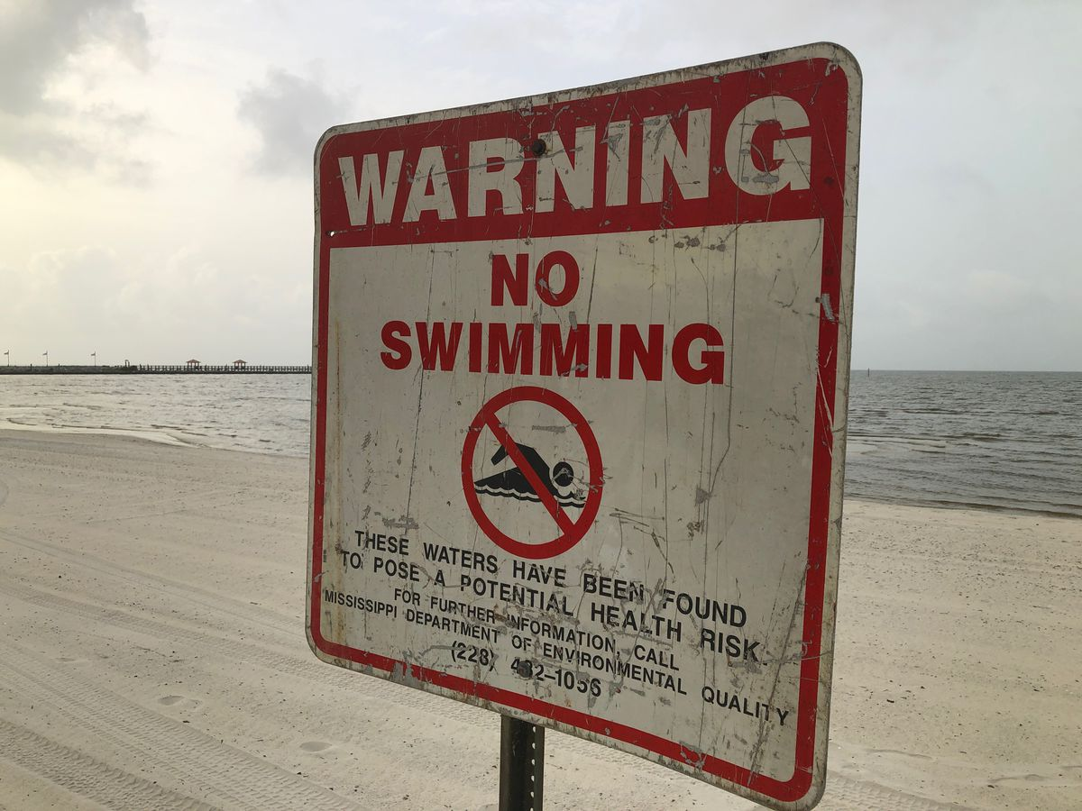 More signs go up along Coast beaches warning of dangerous toxic conditions