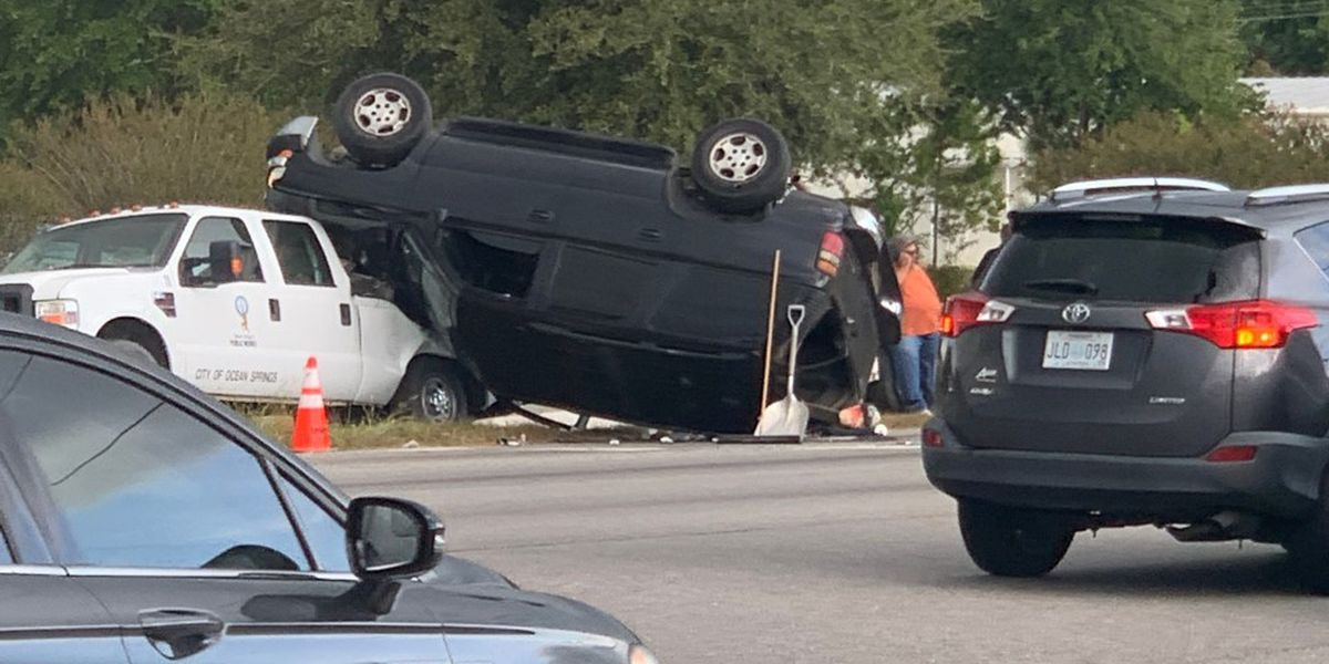 SUV flips over after driving into Ocean Springs city-vehicle