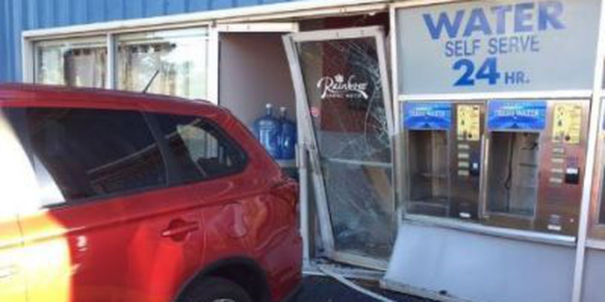 Driver treated for minor injuries after backing into store