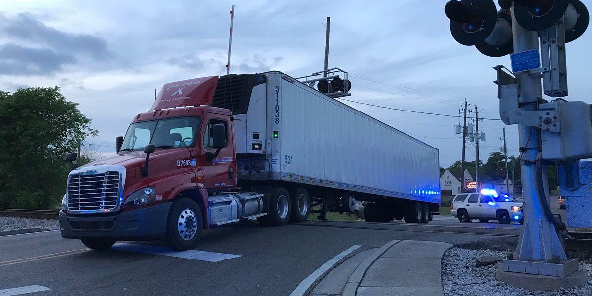 18-wheeler stuck on train tracks in Biloxi