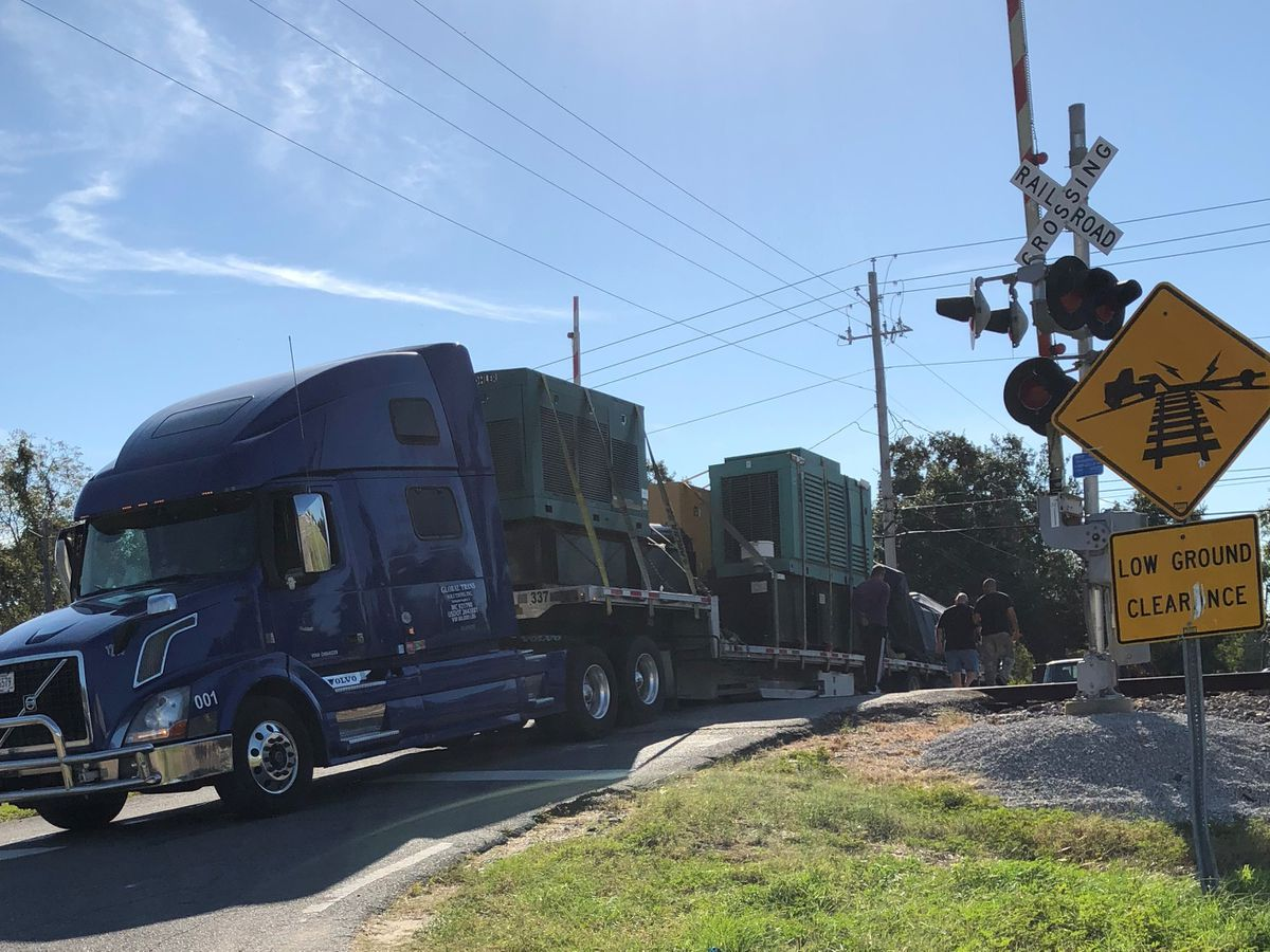 Truck stuck on the railroad tracks in Gulfport